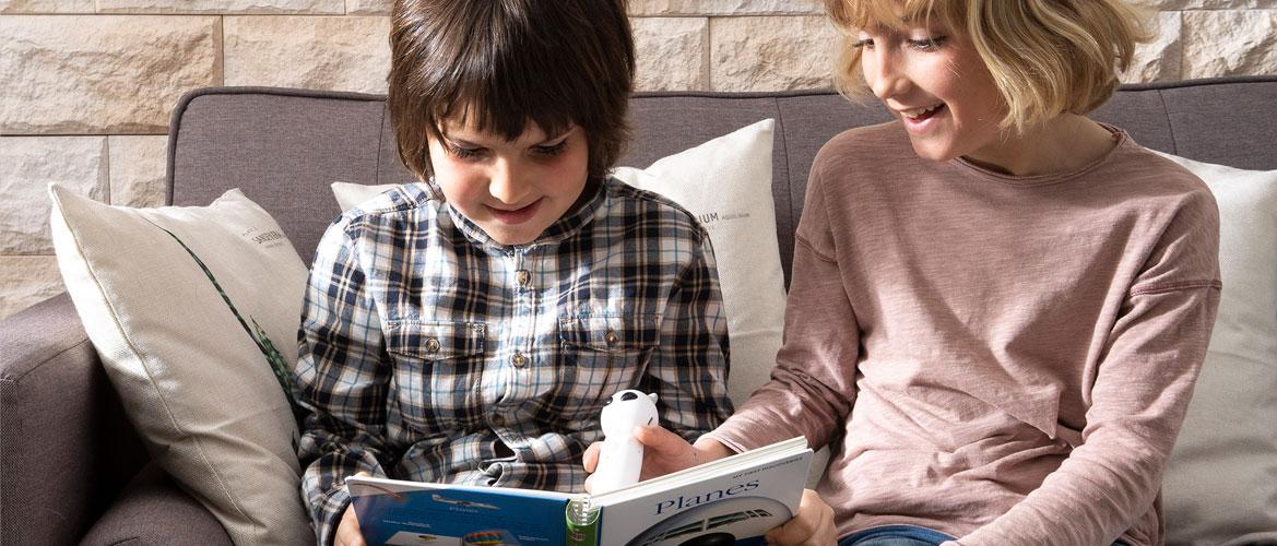 Children reading illustrated information books